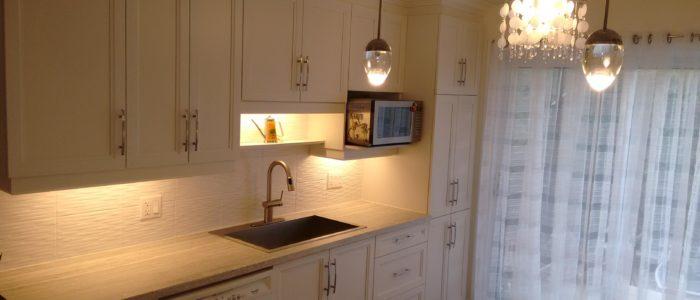 Rénovation de cuisine avec installation et aménagement d'évier et four micro-onde